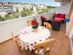 Balcony With Dining Table and Ratan Sofa with chairs
