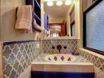 The beautifully appointed bathroom also features Mexican tiles
