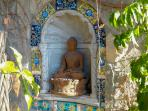 One of the many subtle Buddhas around the property