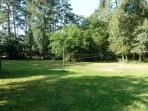 Garden space around the back of the pool (badminton, soft ball cricket, football etc.)