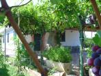 With terraces and BBQ. This rural house is located lain on the outskirts of the small town Tortoli