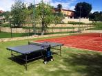 Private tennis court, large open space area around the house, suitable for children.