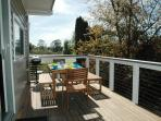 Sunny back balcony is great for breakfasts  & lunches - also has electric barbecue