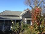 Valley View Cottage Warragul.  Autumn leaves in the front garden a bright splash of colour in Winter