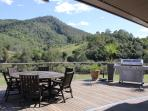 Fixed deck that over looks river and mountain ranges. The perfect BBQ area