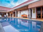our sparkling tropical pool