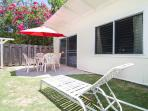 Beautiful Outside Sitting Area w/ Table & Chairs Under an Umbrella