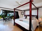 The master king bedroom has direct access to the patio, A/C and en suite bathroom