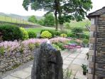 One of the Patio Areas with Water Feature. Perfect for Relaxing with a drink at night or a BBQ
