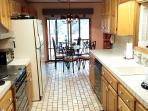 Fully equipped kitchen for your cooking needs w/dining area that overlooks backyard