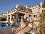 Side rere view of Villa showing Sun Bathing Terrace + Al Fresco Dining area + Pool with Sun Bathing