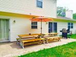 Relax on custom built picnic tables and grill on a large SS BBQ Grill