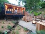 Sitting area with fire bowl/BBQ with subdued outdoor lighting