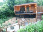 Completely private western red cedar lodge floating above the stream