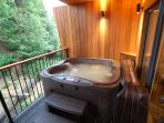 Enjoy the view from the hot tub with jets, waterfall and mood lighting - even if it's raining