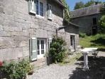 Enjoy meals outside on the sunny gravelled terrace with views of the ancient church