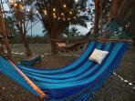 Two large Hammocks hang from the patio trees.