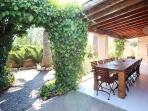 Outdoor dining and small garden area