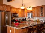 Remodeled Kitchen with Stainless Appliances and Granite