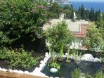 Small fountain with a fish pond and as always the sea view