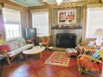CHEERY LIVING ROOM WITH CYPRESS PANELING