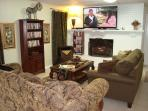 Family room with gas log fireplace, 60' HDTV with DVR, DVD player, premium channels