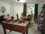 Family room with foosball table.  Door opens to patio,  hot tub. playground, fire pit and lake