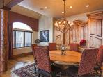 Formal Dining Area Seats Eight Around Custom Round Table in Grand Room.