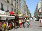 5 min walk, rue Cler, a pedestrian area very lively and charming day and night.