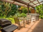 Patio with gas-fired BBQ, outdoor dining area, private hot tub and outdoor shower
