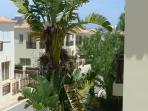 View of Sunset Villas complex and a glimpse of the sea from the balcony