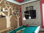 colorful billiards room with large flatscreen tv and sound system