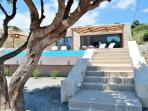 The exterior of the villa, with the staircase that takes you to the beach