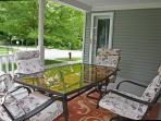 Enjoy your morning coffee or evening dinner out on our porch