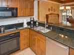 Granite counter tops and all that you need for preparing your meal - except for the food.