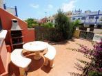 Front garden with dining area, barbecue and seating for eight people