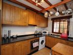 Fully equipped kitchen with oven, hob, washing machine, fridge/freezer, microwave, toaster & kettle
