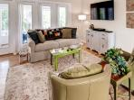 Comfortable seating for parties of up to 15 persons indoors in the family room and kitchen area