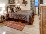 Upstairs guest suite sports a queen-sized bed