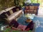 The outdoor living room. The walls are reed, woven with passion vine. Board games are available.