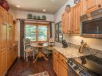 Fully equipped kitchen with additional breakfast seating