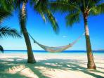 Lounge on the white sandy beach