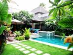surrounded by lush tropical garden