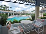 Heated Pool with covered patio, gas grills,and lots of chairs