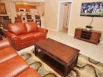 Queen size pull out sleeper sofa, 55inch flat screen TV, DVD, and Free WiFi in living area.
