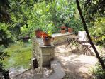 Beautifully shaded terrace on the banks of the Sorgue