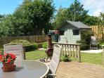 Encosed  mature garden, with chimena, bbq, deck and multiple seating areas