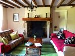 Cosy lounge with original stone flooring & open fire-place