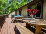 Enjoy your meals in the great outdoors. Huge 40 foot deck with BBQ and two big tables.