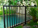 The pool has a removable fence.